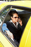 Businesswoman Using Cell Phone in Taxi