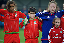 NEWPORT, WALES - Sunday, April 3, 2016: Wales' Amina Vine, Emily Jones and goalkeeper Charlie Short line-up before the game against Northern Ireland on Day 3 of the Bob Docherty International Tournament 2016 at Dragon Park. (Pic by David Rawcliffe/Propaganda)
