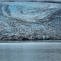 Reid Glacier in Glacier Bay in Alaska<br /> Reid Glacier flows ten miles from its origin at the Brady Icefield before its ¾ mile terminus … which is considered to be small … extends into the Reid Inlet in Glacier Bay National Park.  This mountain glacier flows about 15 feet a day and is retreating about 30 to 50 feet a year.