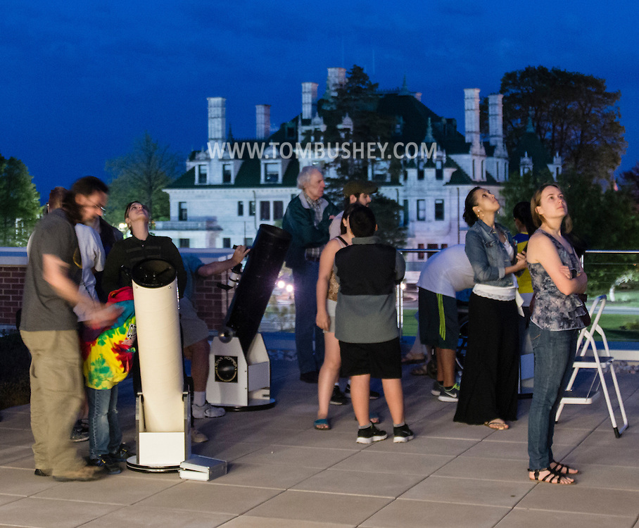 Middletown, New York - People enjoy an astronomy program on viewing constellations and planets on the roof of the Rowley Center for Science and Engineering on the Middletown campus on May 12, 2015. The program was run by SUNY Orange adjunct assistant professor Tom Blon and sponsored by SUNY Orange Cultural Affairs. Morrison Hall is in the background.