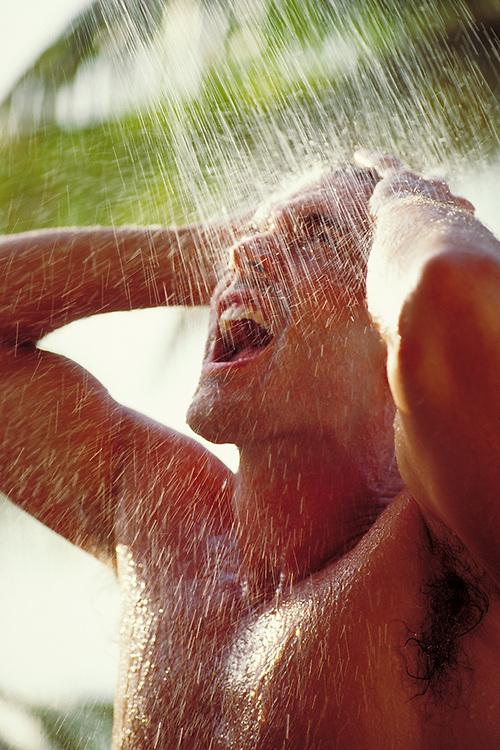 Man enjoying outdoor shower