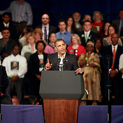 The President Barack Obama signal one with a finger while delivers a powerfull message to the crown