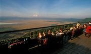 Tourists overlooking Ngorongoro crater (Tanzania) from their lodge