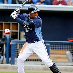 Mar 2, 2013; Port Charlotte, FL, USA; Tampa Bay Rays shortstop Yunel Escobar (11) at bat against the Baltimore Orioles during the bottom of the first inning of a spring training game at Charlotte Sports Park. Mandatory Credit: Derick E. Hingle-USA TODAY Sports