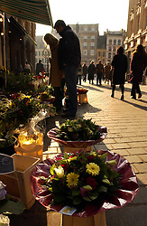 LILLE , FRANCE - FEB-22-2003 - Lille , France has been named the 2004 European Capital of Culture. People shop for flowers on the Grand Place in Lille. (PHOTO © JOCK FISTICK)..