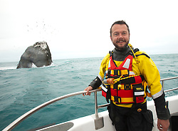 Nick Hancock with Rockall, on his reconnaissance mission for a future 60 day occupation of Rockall. The Rockall Jubilee Expedition, a unique endurance expedition to be undertaken by Nick, in order to raise funds for Help for Heroes .©Michael Schofield..