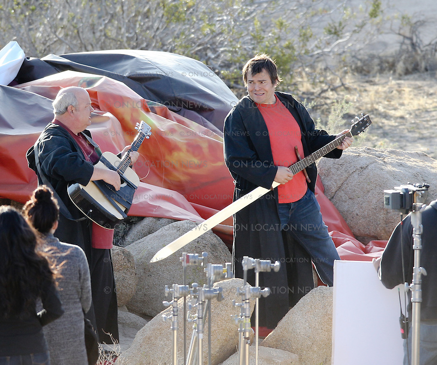 "Jack Black & Kyle Gass film a funny music video for their band ""Tenacious D""  and for a track from their first new album in many years called ""Rize of the Fenix"". Jack Black's wife Tanya Haden was on hand to support her husband and gave him a proud hug after the day long shoot in the desert outside Los Angeles. March 12th 2012 Palmdale, CA. ***EXCLUSIVE***  Photo by Eric Ford/ On Location News 818-613-3955 info@onlocationnews.com"