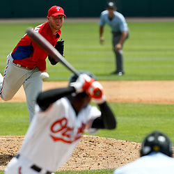March 20, 2012; Sarasota, FL, USA; Philadelphia Phillies starting pitcher Roy Halladay (34) throws against the Baltimore Orioles during the bottom of the fourth inning of a spring training game at Ed Smith Stadium.  Mandatory Credit: Derick E. Hingle-US PRESSWIRE