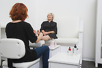 Foot masseuse and client in Palm Springs salon