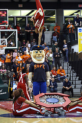 20 March 2010: The Jesse White tumblers borrow the Flying Dutchman as they entertain the crowd during half time.  The Jesse White tumblers are sponsored by Jesse White the Illinois Secretary of State.  The tumblers are from Chicago. The Flying Dutch of Hope College fall to the Bears of Washington University 65-59 in the Championship Game of the Division 3 Women's NCAA Basketball Championship the at the Shirk Center at Illinois Wesleyan in Bloomington Illinois.