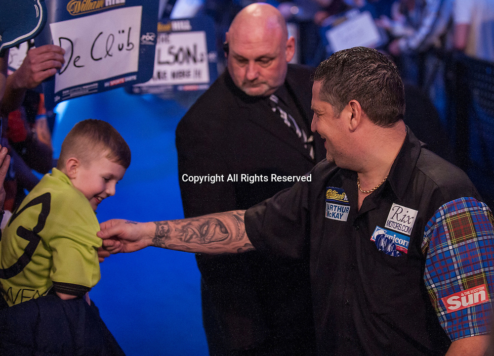 01.01.2014.  London, England.  William Hill PDC World Darts Championship.  Quarter Final Round.  Gary Anderson (4) [SCO] ribs a young Michael van Gerwen fan as he makes his way to the stage before his match against Peter Wright (5) [SCO]