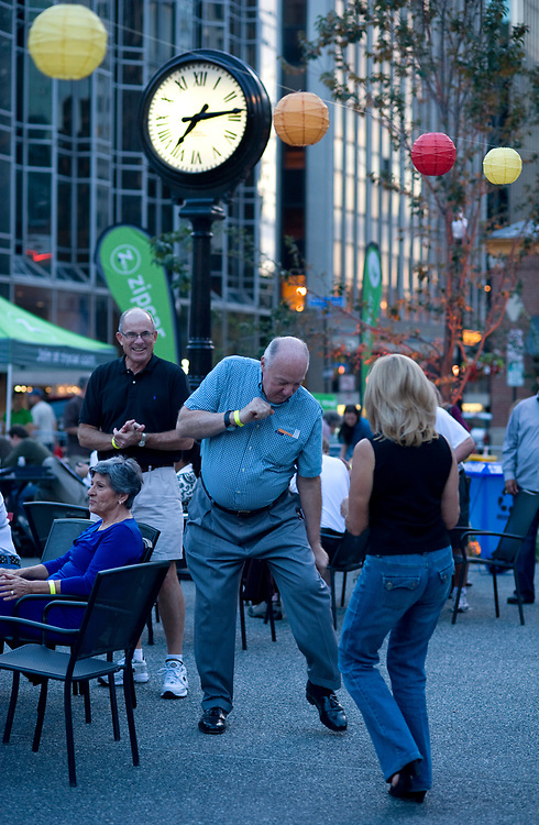Roger Valente, of Sewickley, dances with Linda Bannon (of The Heinz Endowments) at the annual Downtown Neighborhood Block Party in Market Square.