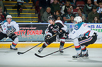KELOWNA, CANADA - MARCH 21: Alec Baer #8 of Vancouver Giants passes the puck against the Kelowna Rockets on March 21, 2015 at Prospera Place in Kelowna, British Columbia, Canada.  (Photo by Marissa Baecker/Shoot the Breeze)  *** Local Caption *** Alec Baer;