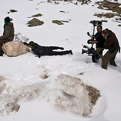 The steadicam operator follow the actor Trond Espen Seim as he crawls through the snow.