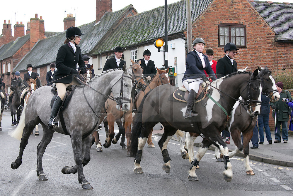 © Licensed to London News Pictures.26/12/12014. Market Bosworth, Leicestershire, UK. The annual Boxing Day Hunt Meeting took place in the market square earlier today. Pictured, the hunt makes it's way through the market town. Photo credit : Dave Warren/LNP