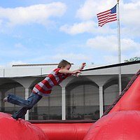 Bentley Whitworth of Aberdeen hops from one inflatable ball to another on the Leaps and Bounds inflatable at the Kids Zone.