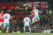Daley Blind Midfielder of Manchester United jumps in the air for a header with West Ham Midfielder Sofiane Feghouli during the EFL Cup Quater-Final between Manchester United and West Ham United at Old Trafford, Manchester, England on 30 November 2016. Photo by Phil Duncan.