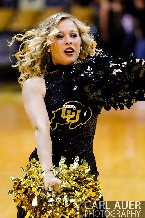 November 13th, 2013:  A Colorado Buffaloes cheerleader prior to the start of action in the NCAA Basketball game between the University of Wyoming Cowboys and the University of Colorado Buffaloes at the Coors Events Center in Boulder, Colorado