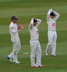 Dejection for Sussex's Chris Nash, Luke Wright and Ben Brown as Somerset's Craig Overton survives the hat trick ball bowled by Sussex's Steve Magoffin - Photo mandatory by-line: Harry Trump/JMP - Mobile: 07966 386802 - 07/07/15 - SPORT - CRICKET - LVCC - County Championship Division One - Somerset v Sussex- Day Three - The County Ground, Taunton, England.