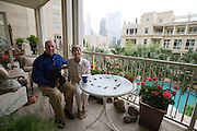 Kyle and Anne Crews pose for a photo with their new puppy Mac in their home at the Tower Residences at the Ritz-Carlton in Dallas on Wednesday, April 17, 2013. (Cooper Neill/The Dallas Morning News)