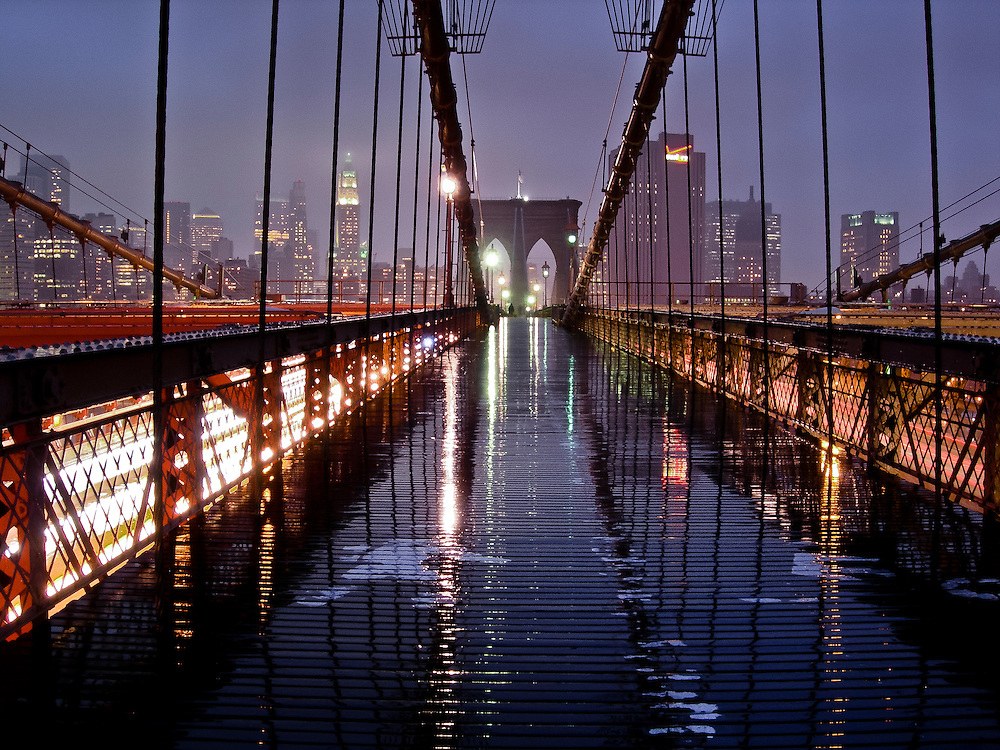 Reflection of the Brooklyn bridge cables after the rain by sunset, Brooklyn, New York.