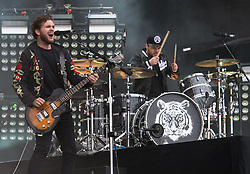 © Licensed to London News Pictures. 29/08/2015. Reading Festival, UK.  Royal Blood performing at Reading Festival 2015, Day 2.  In this picture - Mike Kerr (left), Ben Thatcher (Right).  Photo credit: Richard Isaac/LNP