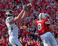 University of Missouri tight end Chase Coffman (45) pulls in a 19-yard touchdown pass from Chase Daniel over Nebraska safety Andrew Shanle (8) in the fourth quarter at Memorial Stadium in Lincoln, Nebraska, November 4, 2006.  The Huskers beat the Tigers 34-20.<br />