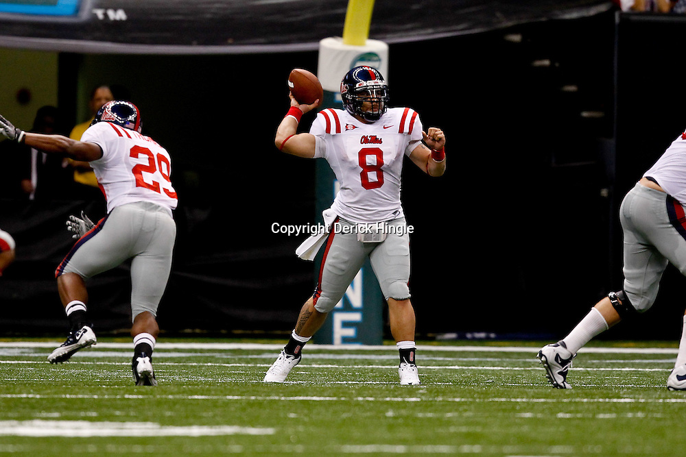 Sep 11, 2010; New Orleans, LA, USA; Mississippi Rebels quarterback Jeremiah Masoli (8) passes the ball during a game against the Tulane Green Wave at the Louisiana Superdome. The Mississippi Rebels defeated the Tulane Green Wave 27-13.  Mandatory Credit: Derick E. Hingle