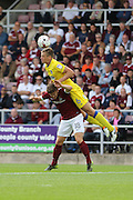 AFC Wimbledon defender Paul Robinson (6) and Northampton Town defender Aaron Phillips (18) in action during the EFL Sky Bet League 1 match between Northampton Town and AFC Wimbledon at Sixfields Stadium, Northampton, England on 20 August 2016. Photo by Stuart Butcher.