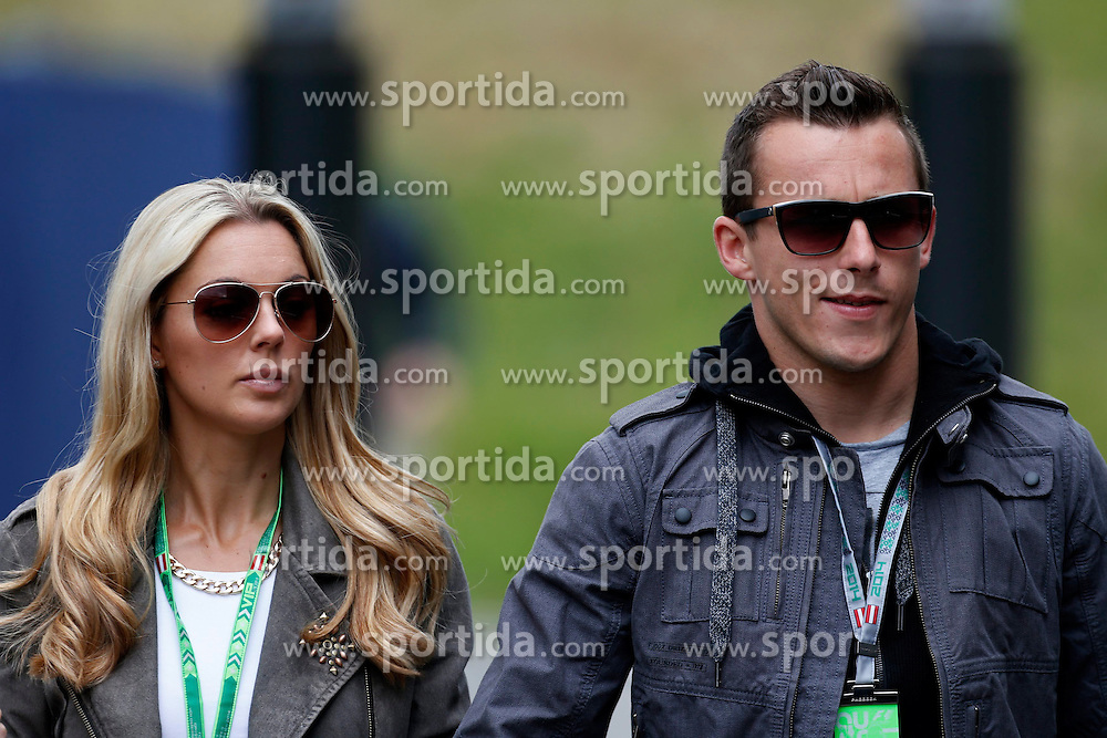 21.06.2014, Red Bull Ring, Spielberg, AUT, FIA, Formel 1, Grosser Preis von &Ouml;sterreich, Qualifying, im Bild Christian Klien (AUT) and girlfriend. // during the qualifying of the Austrian Formula One Grand Prix at the Red Bull Ring in Spielberg, Austria on 2014/06/21. EXPA Pictures &copy; 2014, PhotoCredit: EXPA/ Sutton Images/ Martini<br /> <br /> *****ATTENTION - for AUT, SLO, CRO, SRB, BIH, MAZ only*****