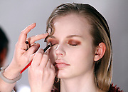 Models prepare backstage at Christian Siriano during the Mercedes-Benz Fall/Winter 2015 shows at Artbeam in New York City, New York on February 14, 2015.
