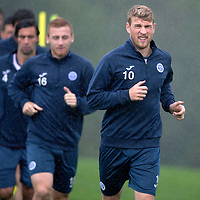 St Johnstone Training....21.09.15<br /> David Wotherspoon leads a run during training at a very wet McDiarmid Park this morning<br /> Picture by Graeme Hart.<br /> Copyright Perthshire Picture Agency<br /> Tel: 01738 623350  Mobile: 07990 594431