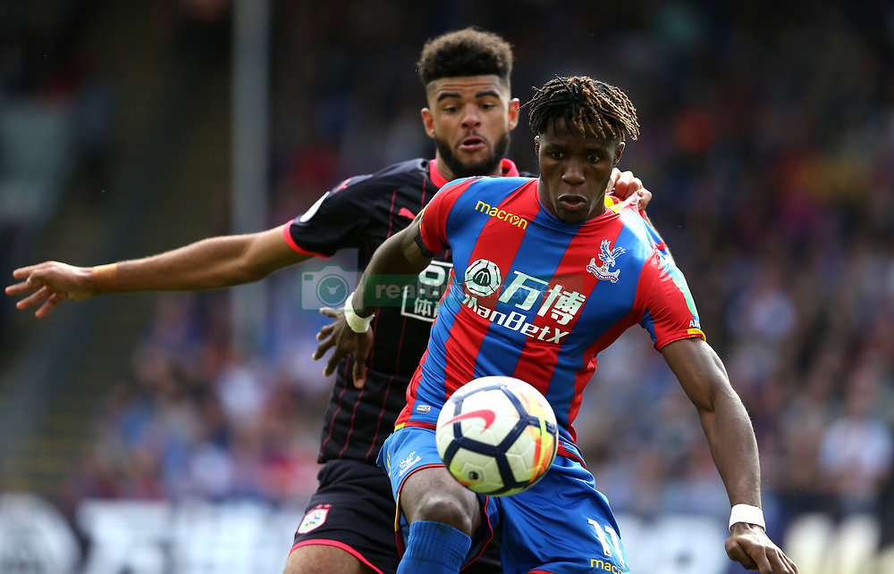 12 August 2017 London : Premier League Football : Crystal Palace v Huddersfield Town: Wilfried Zaha of Palce is held back by Philip Billing: Photo: Mark Leech