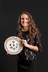 Casey Stoney poses with the PFA Special Achievement Award plate during the 2018 PFA Awards at the Grosvenor House Hotel, London