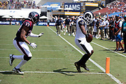 Los Angeles Rams wide receiver Pharoh Cooper (10) is chased by Houston Texans rookie defensive back Andre Chachere (37) as he catches a 6 yard touchdown pass that ties the first quarter score at 7-7 during the 2018 NFL preseason week 3 football game against the Houston Texans on Saturday, Aug. 25, 2018 in Los Angeles. The Rams won the game 21-20. (©Paul Anthony Spinelli)