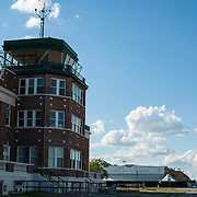 September 9, 2012 - Brooklyn, NY : Once New York City's municipal airport, Floyd Bennett Field is now administered by the Parks Department as a recreation site. The old runways remain -- providing ideal space to ride bikes and fly model airplanes.  The Ryan Center, at left, which was the old terminal and control tower, now houses a visitors center and park department offices.  CREDIT: Karsten Moran for The New York Times