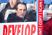 Unai Emery of Arsenal (Manager) looks on from his seat on the Arsenal bench during the Premier League match between Huddersfield Town and Arsenal at the John Smiths Stadium, Huddersfield, England on 9 February 2019.