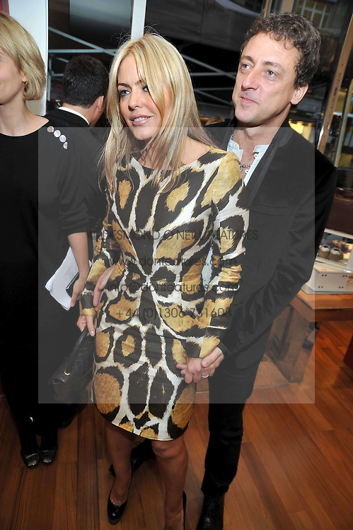 PATSY KENSIT and JEREMY HEALY at a party in aid of the charity Best Buddies held at the Hogan store, 10 Sloane Street, London SW10 on 13th May 2009.