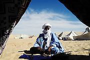 Tuareg man sells handicrafts in Timbuktu during the 2010 edition of the Festival au Désert
