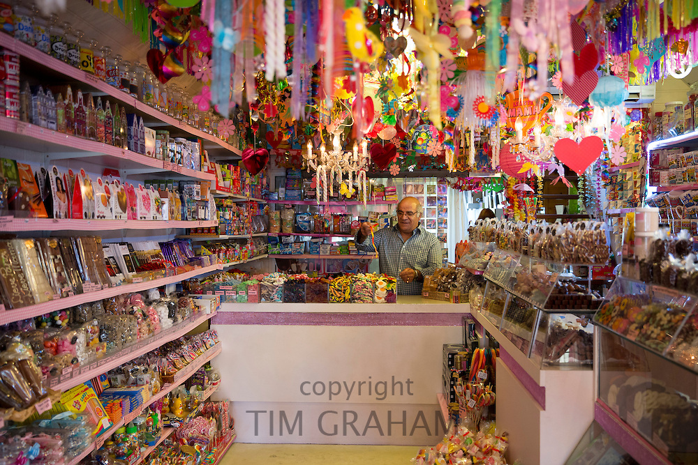 Shopkeeper in chocolaterie sweet shop candy and gift store, Snoepwinkeltje, Edam, The Netherlands