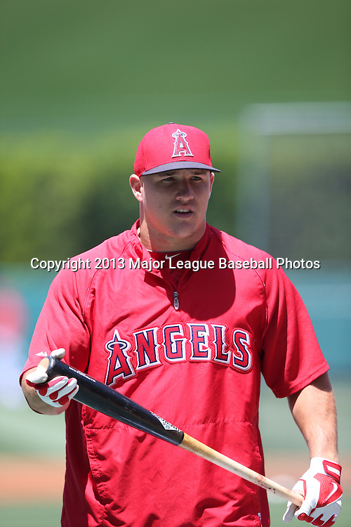 ANAHEIM, CA - JUNE 15:  Mike Trout #27 of the Los Angeles Angels of Anaheim looks on during batting practice before the game against the New York Yankees on Saturday, June 15, 2013 at Angel Stadium in Anaheim, California. The Angels won the game 6-2. (Photo by Paul Spinelli/MLB Photos via Getty Images) *** Local Caption *** Mike Trout