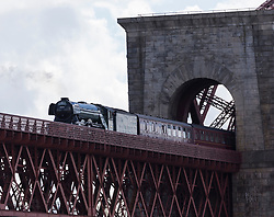 The famous Flying Scotsman crosses the Forth Bridge into Fife on its circular tour