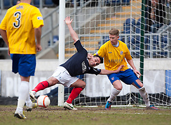 Falkirk's Sean Higgins tackled by Cowdenbeath's David Cowan.<br /> Falkirk 4 v 0 Cowdenbeath, 6/4/2013.<br /> &copy;Michael Schofield.