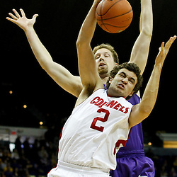 November 12, 2011; Baton Rouge, LA; Nicholls State Colonels forward Lachlan Prest (2) rebounds over LSU Tigers center Justin Hamilton (41) during the first half of a game at the Pete Maravich Assembly Center.  Mandatory Credit: Derick E. Hingle-US PRESSWIRE