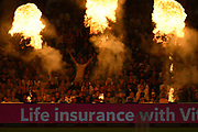 A spectator celebrate a boundary as the flames light up the stand during the Vitality T20 Finals Day 2019 match between Worcestershire County Cricket Club and Essex County Cricket Club at Edgbaston, Birmingham, United Kingdom on 21 September 2019.