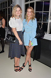 Left to right, AMBER ATHERTON and GRETA BELLAMACINA at the OFFtheGRID event - a solar-powered party on a London rooftop to support our renewable energy future hosted by Dame Vivienne Westwood supported by the Trillion Fund at 151-155 New North Road, London N1 on 4th September 2014.