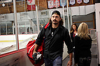 14 December 2012:  George Parros carries in his own hockey bag to the rink. NHLPA players skated in a Charity Game at The Rinks -Anaheim Ice benefiting the Jr. Ducks Pee Wee AAA team and The Children's Hospital of Orange County.  The players skated 4 on 4 with a standing room only capacity of fans with over 500 tickets sold. The White team won the game 10-6 in a Ducks vs Kings lineup.  The NHL is in its 92nd day of locking out their players.