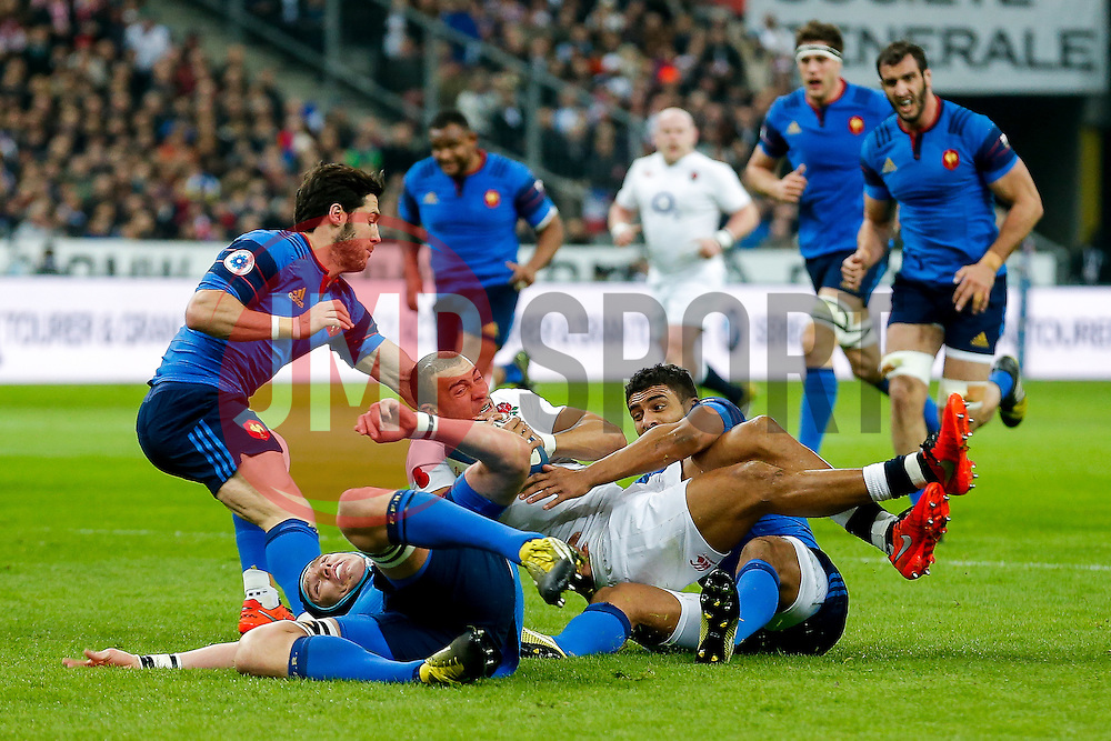 England Outside Centre Jonathan Joseph is tackled by France Winger Wesley Fofana - Mandatory byline: Rogan Thomson/JMP - 19/03/2016 - RUGBY UNION - Stade de France - Paris, France - France v England - RBS 6 Nations 2016.
