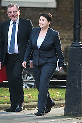 © Licensed to London News Pictures. 12/09/2017. London, UK. Secretary of State for Scotland DAVID MUNDELL (left) and leader of the Scottish Conservatives RUTH DAVIDSON (right) arrive at 10 Downing Street in London ahead of a cabinet meeting.  In the early hours of this morning government won a vote in Commons passing the EU repeal bill, by a margin of 326 to 290 votes. Photo credit: Ben Cawthra/LNP
