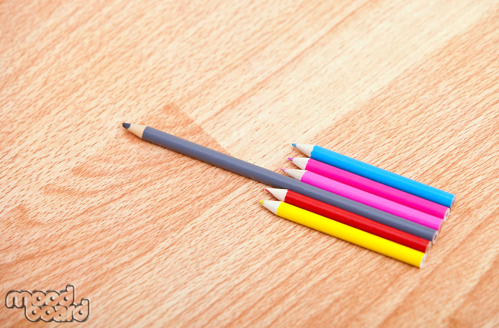 Studio shot of colored pencils in a row